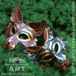 Photo of two wolf masks on a green background