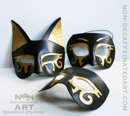 Trio of Egyptian Masks on a white background