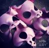 Closeup of four leather pig masks