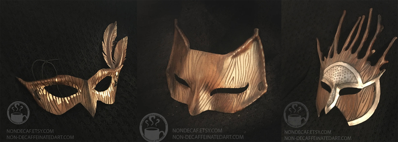 A set of three leather costume masks carved with a woodgrain pattern