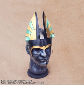 photo showing a green and gold anubis styled headdress