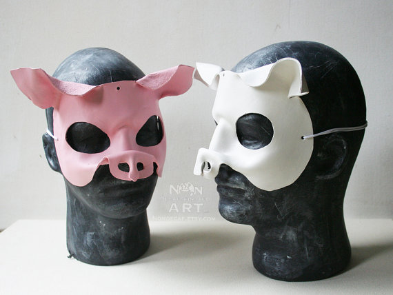 Photo Showing a white and a pink pig mask