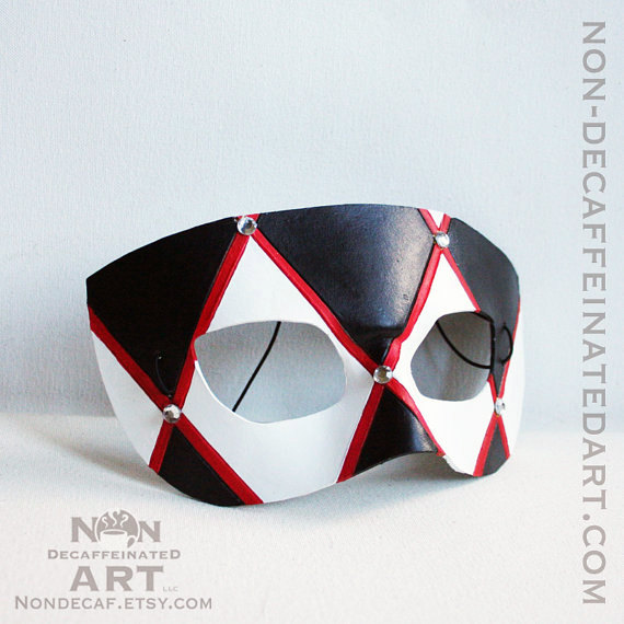 Photo showing a red white and black mask with silver acrylic gems