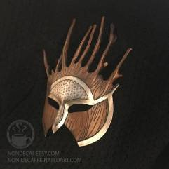 Photo showing a 3/4 view of a silver and brown mask