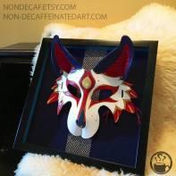 Photo showing a framed mask