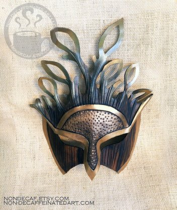 Photo of a gold and brown mask with sytlazed leaf accents