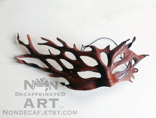photo of a leather mask that resembles tree branches