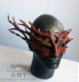 phphoto of a leather mask that resembles tree branches