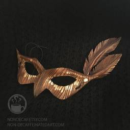 Photo of a Leather mask with leather Feather accents