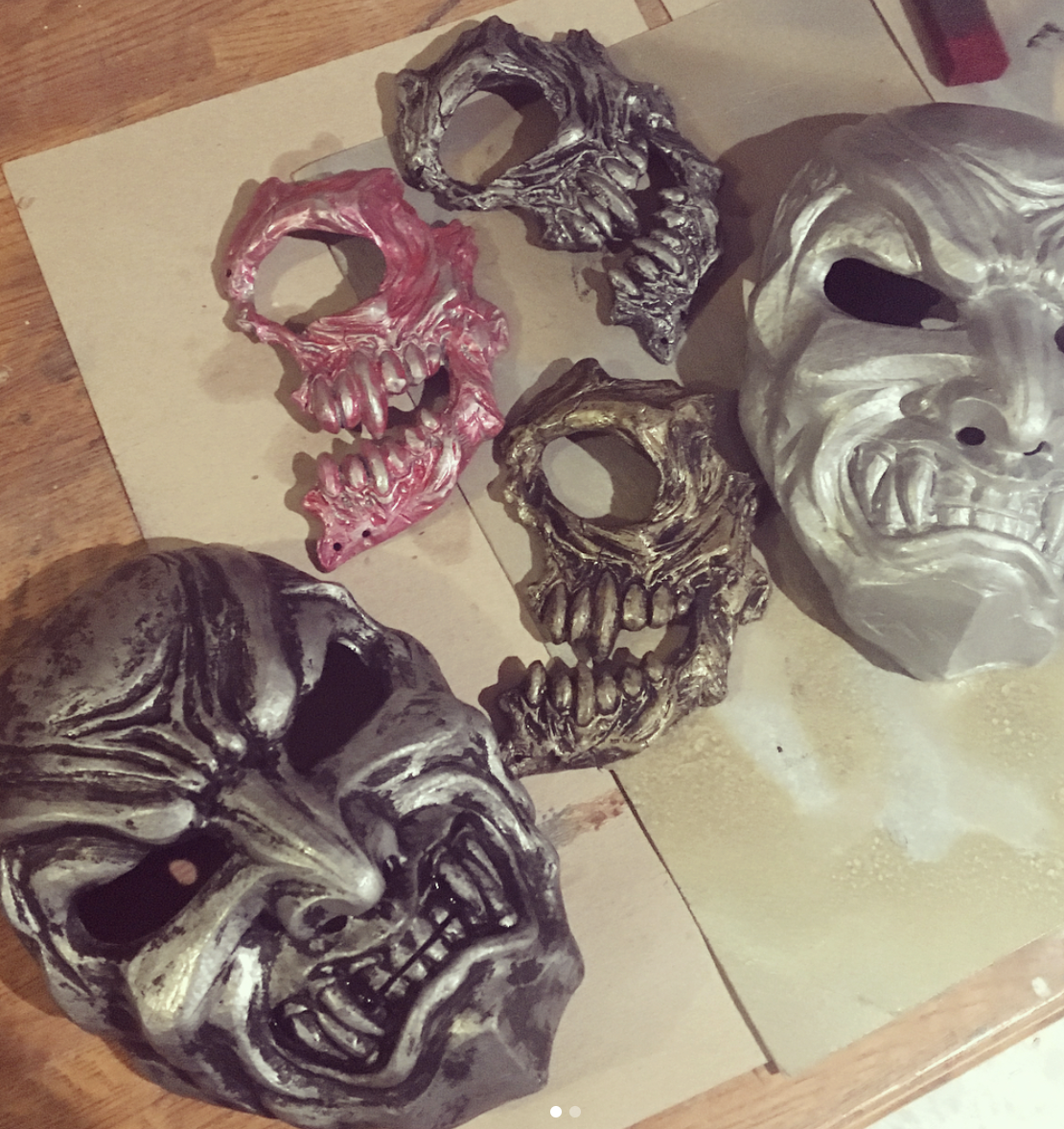 resin masks with first coat of paint