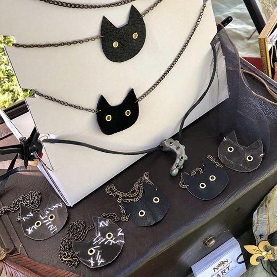 Display of black cat necklaces
