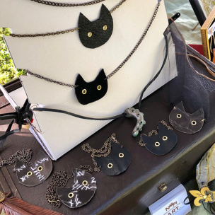 Display of black cat necklaces