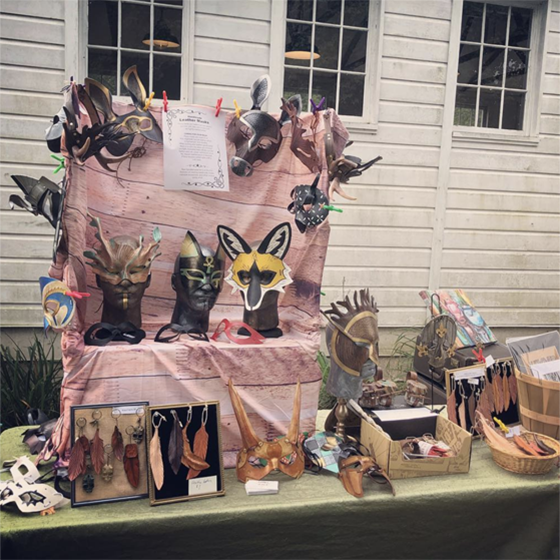 craft fair display of leather masks